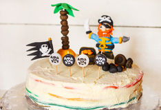 Homemade pirate rainbow cake for kid birthday Stock Photos