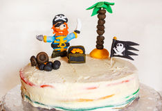 Homemade pirate rainbow cake for kid birthday Stock Photography