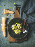 Homemade pistachio ice cream scoops with crashed pistachio nuts Stock Photography