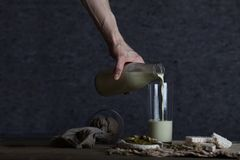 Homemade pistachio nut milk in a glass bottle royalty free stock images