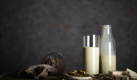Homemade pistachio nut milk in a glass bottle stock images