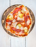 Homemade Pizza on brown cutting board Stock Images