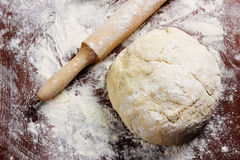 Homemade pizza dough with rolling pin Stock Photos