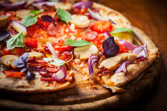 Homemade pizza with dried tomatoes and salami Stock Photo