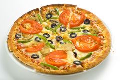 Homemade pizza fresh tomato olive mushroom cheese Stock Photography