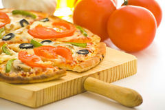 Homemade pizza fresh tomato olive mushroom cheese Stock Photos