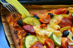 Homemade pizza with fresh tomatoes, peppers, olives, mushroom and cheese Stock Photos