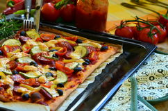 Homemade pizza with fresh tomatoes, peppers, olives, mushroom and cheese Royalty Free Stock Photography