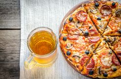 Homemade pizza with a glass of beer Royalty Free Stock Photo