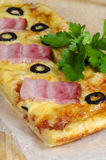 Homemade pizza with ham, cheese and olives Stock Image