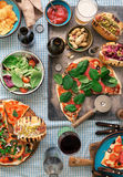 Homemade pizza, hot dogs, wine, beer and snack for beer. Outdoors food concept. Homemade pizza, hot dogs, wine, beer and a snack for beer on the table, top view stock images
