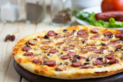 Homemade Pizza with hunter sausages Stock Images