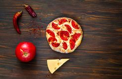 Homemade pizza Margarita and ingredients on wooden background, balanced food concept,copy space, closeup,. royalty free stock images