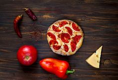 Homemade pizza Margarita and ingredients on wooden background, balanced food concept,copy space, closeup,isolated. royalty free stock images