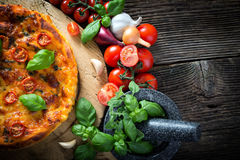 homemade pizza margherita with mozzarella, basil and tomatoes Royalty Free Stock Photo