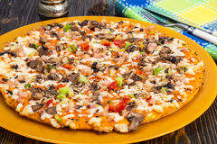 Homemade Pizza on orange plate Royalty Free Stock Images