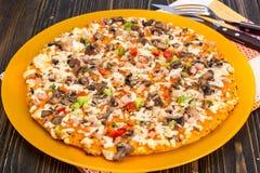 Homemade Pizza on orange plate Stock Photo