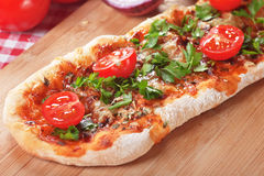 Homemade pizza with parsley and cherry tomato Stock Images