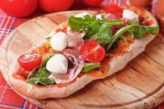 Homemade pizza with prosciutto and mozzarella Stock Photo