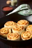 Homemade Pizza Rolls or Pinwheels. Filled with ham, onion, tomato sauce and cheese, photographed with natural light Selective Focus, Focus on the middle of the stock images