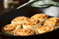 Homemade Pizza Rolls or Pinwheels. Filled with ham, onion, tomato sauce and cheese, photographed with natural light Selective Focus, Focus on the middle of the Stock Image