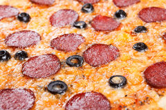 Homemade pizza with salami, parmesan cheese,  background closeup Royalty Free Stock Photos