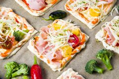 Homemade pizza sandwiches on a baking paper Royalty Free Stock Photo