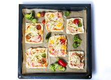 Homemade pizza sandwiches on a baking paper Royalty Free Stock Photos