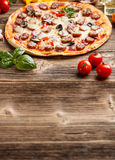 Homemade pizza. Served on wooden table royalty free stock images