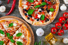 Homemade Pizza with tomato sauce, artichoke hearts, olives, Parm Royalty Free Stock Photos
