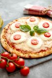 Homemade pizza with tomatoes, mozzarella stock photos