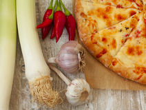 Homemade  pizza on a wooden background Stock Photography