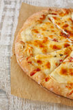 Homemade  pizza on a wooden background Royalty Free Stock Image