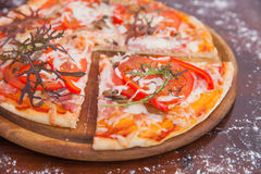 Homemade Pizza on Wooden Background Stock Image
