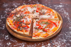 Homemade Pizza on Wooden Background Stock Photos