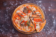 Homemade Pizza on Wooden Background Stock Photography
