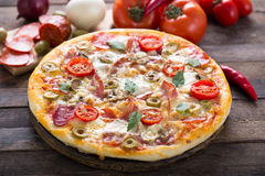 Homemade pizza. On the wooden table royalty free stock photography