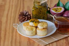 Homemade plain scones serve with homemade passion fruit jam. Scones is English pastry for afternoon tea,cream tea. Delicious stock image