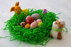 A homemade and plaited Easter nest made from yeast dough with colorful easter eggs and little chicks. royalty free stock image