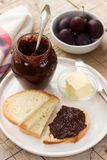 Homemade plum jam with chocolate. Toasts with jam. Rustic style, selective focus. Stock Photography