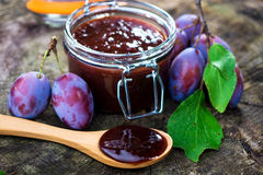 Homemade plum jam. With freshly picked plums on wooden table Stock Photography