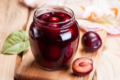 Homemade plum jam in glass jar. Royalty Free Stock Photography