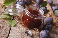 Homemade plum marmalade in a glass jar. horizontal Stock Image