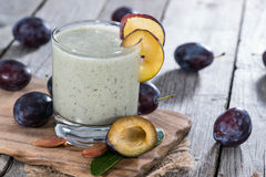 Homemade Plum Smoothie. On vintage wooden background Royalty Free Stock Image