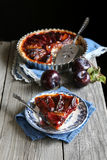Homemade plum tart on wooden board Stock Image