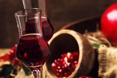 Homemade pomegranate liqueur, still life in rustic style, old wooden table background, selective focus stock photos