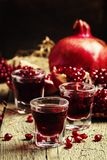 Homemade pomegranate liqueur, still life in rustic style, vintag stock images