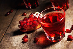 Homemade pomegranate liqueur, still life in rustic style, vintage wooden background, selective focus stock photography