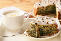 Homemade poppy seed cake and cup of coffee. Stock Photos