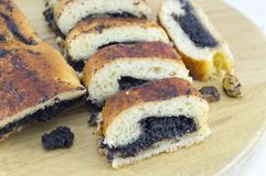 Homemade poppy seed strudel sliced on the wooden board Stock Photos